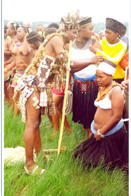 A Zulu maiden receives blessings from her father during her umemulo ceremony...Image by Greyling B