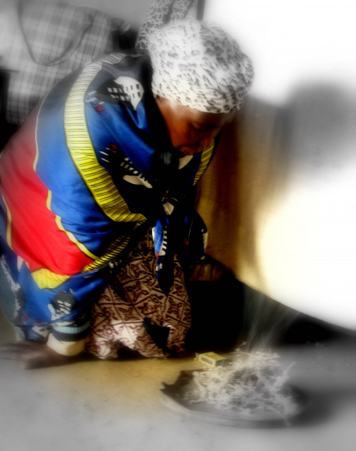 A sangoma (diviner) communicates with the ancestors over imphepho. Image by africashamanexperience.com