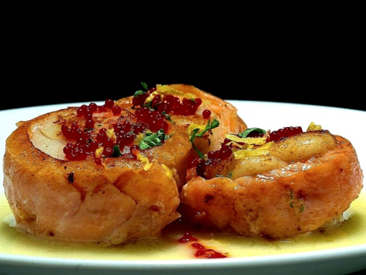 Salmon wrapped with scallops and served with beurre blanc sauce and caviar. Yum!