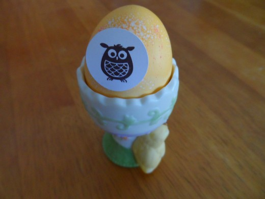 Rubberstamped owl and 1 inch punch to cut out, glue dot to adhere it to the dyed egg.