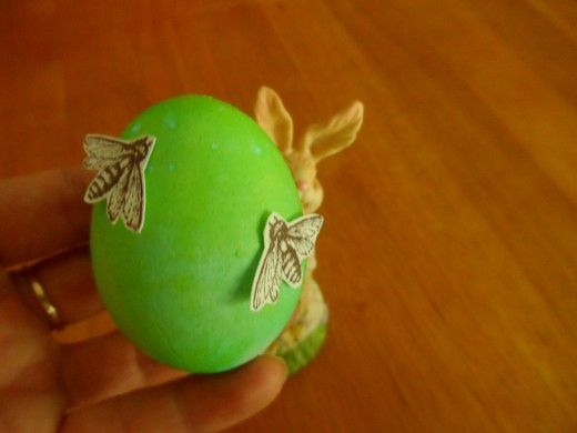 Rubberstamped bees, hand cut like punch art and adhered to the egg with glue dots.
