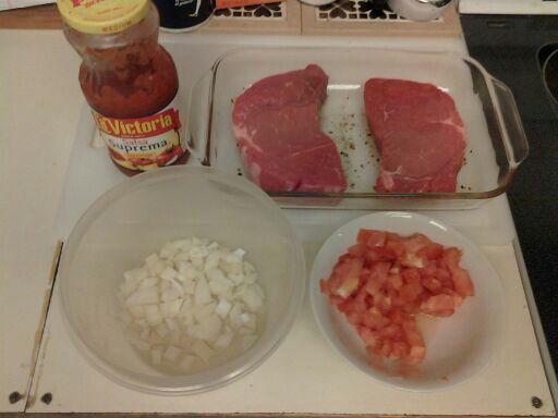 Needed ingredients for an easy baked steak dinner.