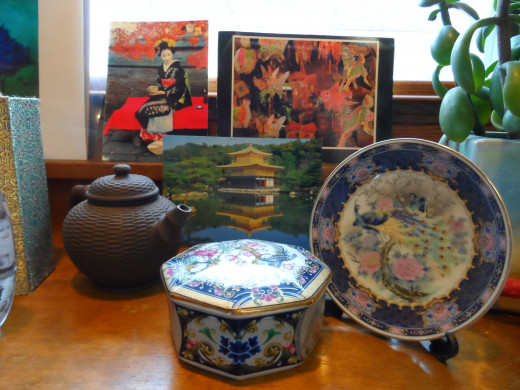 Mini Teapots and small dishes from China add to the Asian theme.