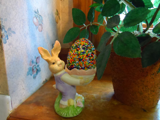 Seed bead covered egg in a bunny egg holder