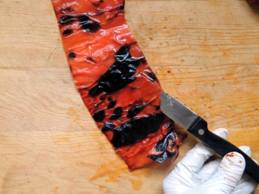 slip sharp paring knife carefully between skin and pepper