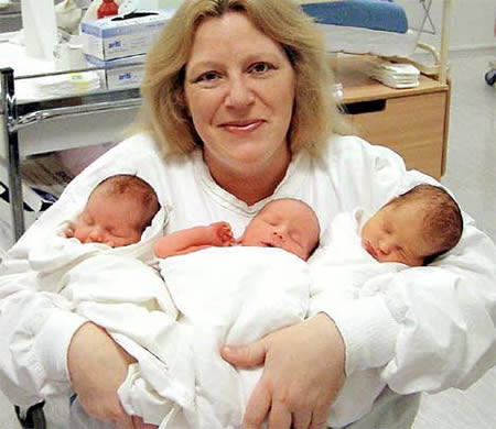 Carole Horlocke has the distinction of being the world's most prolific surrogate mom. In thirteen years she birthed twelve babies for other women - including this set of triplets.
