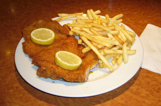 German Schnitzel with lemon slices and french fries