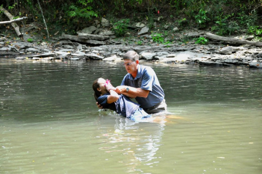 Baptizing my daughter in The Little Miami River Beavercreek, Ohio