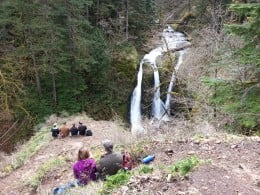 A group viewing triple falls from a distance.