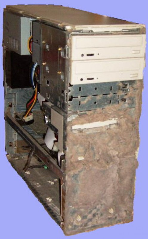The air in this PC is pulled in through a slot at the bottom of the front plastic panel. Over a couple of years, much dust has accumulated, the machine regularly overheats and freezes.