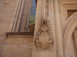 A stone angel as part of a cathedral in Sydney, Australia.