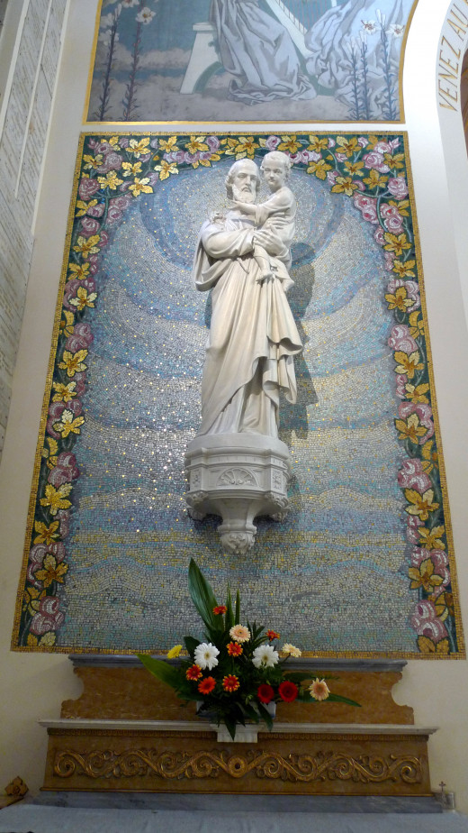 St. Joseph is frequently depicted holding the Baby Jesus and/or with his associated flower, the lily.
