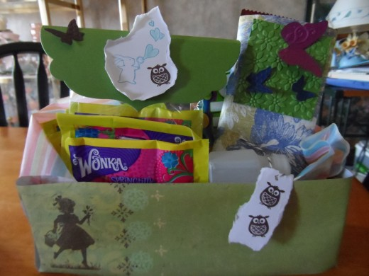 Teen girl Easter basket. Candy bar covered in designer paper, decorative label for fun dip and a bottle of bubbles. Tissue paper lines the bottom of the box.