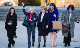 Edith Windsor, second left, arrives at the supreme court in Washington on Wednesday morning as the court is to hear arguments in her case against on the constitutionality the 1996 Defense of Marriage Act. Photograph: Pete Marovich/ZUMA Press/Corbis