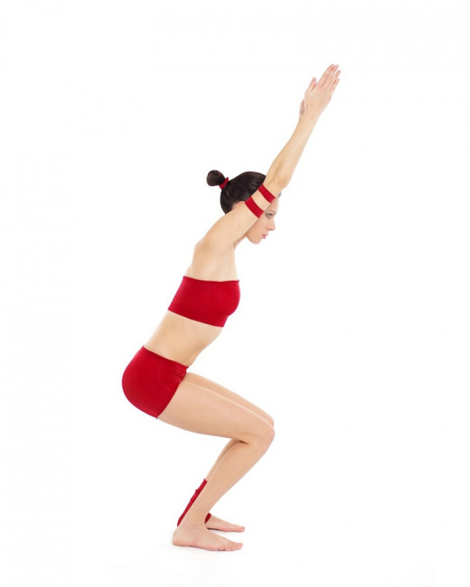 Chair Pose or Utkatasana improves balance and tones the leg and back muscles.
