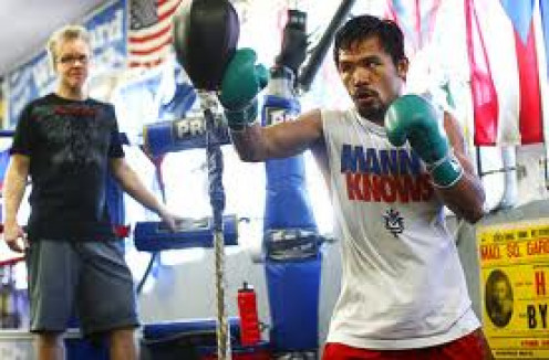 8 Division world champion Manny Pacquiao hits the double end bag. This bag can help practice timing, accuracy and throwing fast combinations. Also, The double end bag is a perfect way to work on slipping punches.