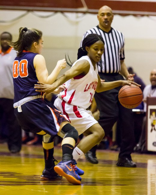 From the NJ girls basketball tournament. Action shots like this require high shutter speeds, open apertures, and high ISOs.