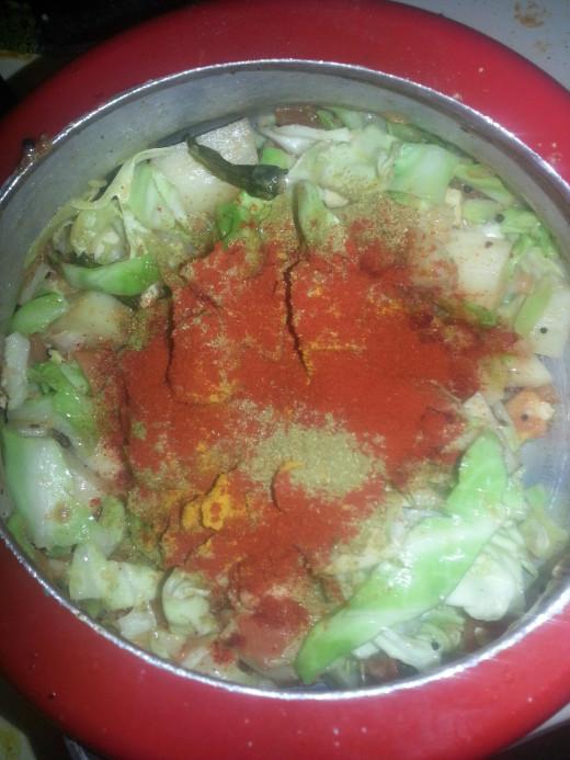 Add chilli,  coriander and turmeric powder