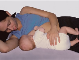 how to hold baby while breastfeeding