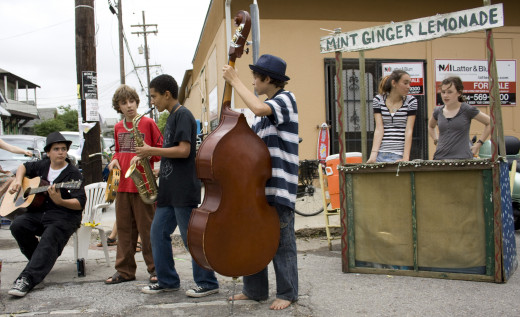 Kids make money selling lemonade and playing music.