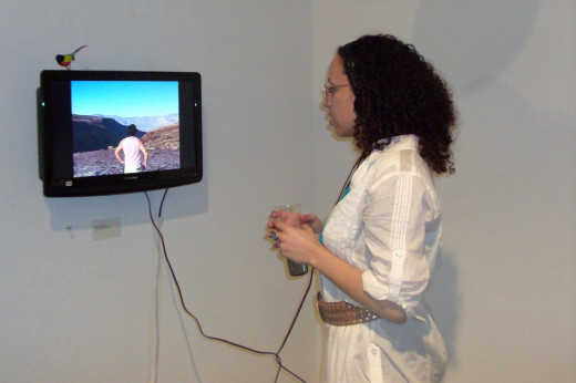 Art isn't always a painting or sculpture. Video art is another form of art you might find at a gallery or museum. Photo of myself watching a video by artist Chris Vargas.