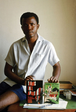 The young Chinua Achebe displaying his first novel 'Things Fall Apart'