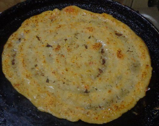 Dosa getting cooked in the tawa
