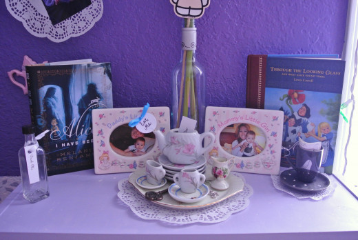 I found the tiny child's tea set at an antique store and the tea themed picture frames at a thrift store.