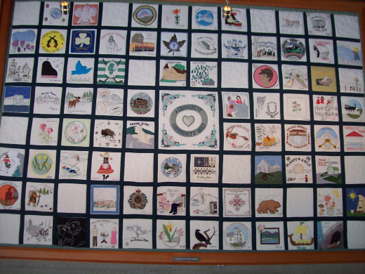 A community quilt remembering those who lost their lives.