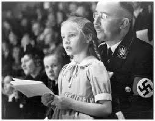 Himmler pictured with a child of the Lebensborn.