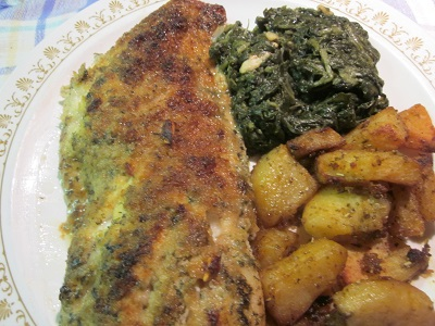 Red Snapper with garlic spinach and oven baked herb  potatoes.