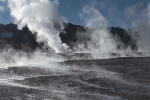 Steam coming out of the ground is a sign of high underground temperatures at the spot; this energy, called geothermal, can be exploitated.