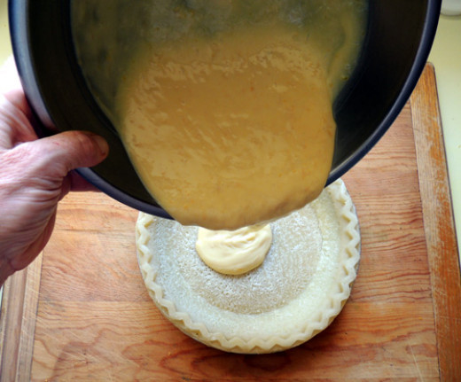 pour custard into pie shell, and cook 10 minutes