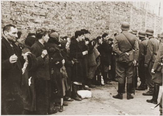 Photo from the Warsaw Ghetto Uprising.  This was a search and interrogation for weapons of captured Jews, before being taken to the Umschlagplatz.  So they were unable to defend themselves and fight back.