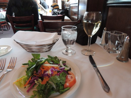 Ensalada mixta (mixed salad) at Mallorca restaurant and a glass of white Rioja wine from the Marques Cacerces bodega.