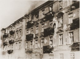 A Jewish man jumps from the top floor to avoid capture.  Warsaw Ghetto.
