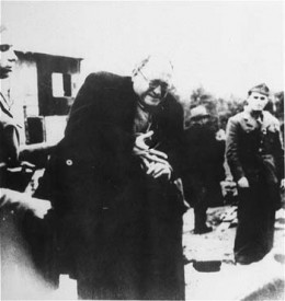 Jewish prisoner being forced to take off a ring as he arrived in the Jasenovac concentration camp..