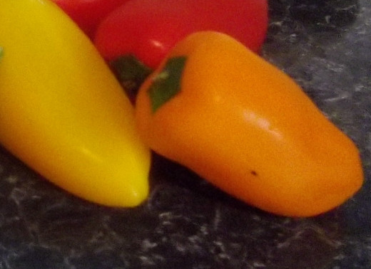 Red yellow and orange sweet pepers.