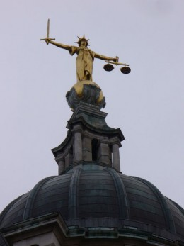 """""""The Scales of Justice"""". Gilded bronze figure on top of the dome of the Central Criminal Court on Old Bailey. The figure was designed by Frederick William Pomeroy. Author: Colin Smith"""