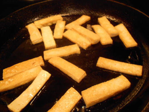 Cook the Tofu in a skillet on a medium heat, turning two or three times until crisp and dry.