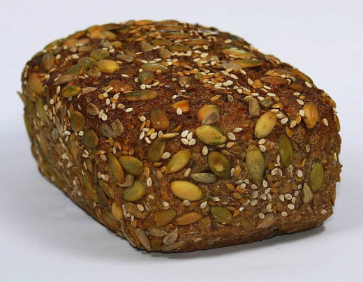 Delightful Essene Loaf made with spelt grain and pumpkin seeds. Pepitas can be added to many bread and roll recipes.