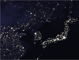 """In this nighttime satellite view of Asia North Korea is mostly dark in stark contrast to its neighbors, an almost perfect illustration of the """"Hermit Kingdom's"""" isolation."""