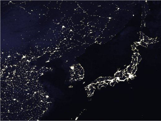 "In this nighttime satellite view of Asia North Korea is mostly dark in stark contrast to its neighbors, an almost perfect illustration of the ""Hermit Kingdom's"" isolation."