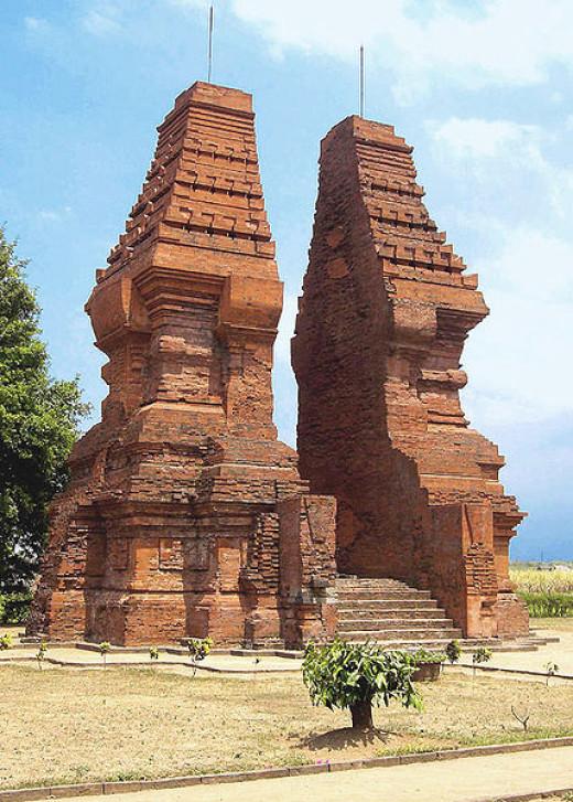 Wringin Lawang (lit: The Banyan Tree Gate), the 14th century grand split gate. Located at short distance south of the main road at Jatipasar, Trowulan, Mojokerto, East Java, Indonesia.