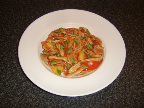 Chicken thigh meat and egg noodles stirred through homemade sweet and sour sauce