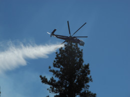 Not a great shot, but it does show the water spray coming from the Tanker.