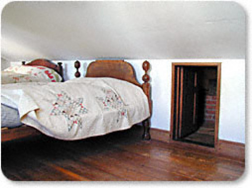Entrance to garret, the beds moved in front of the door to hide its existence.