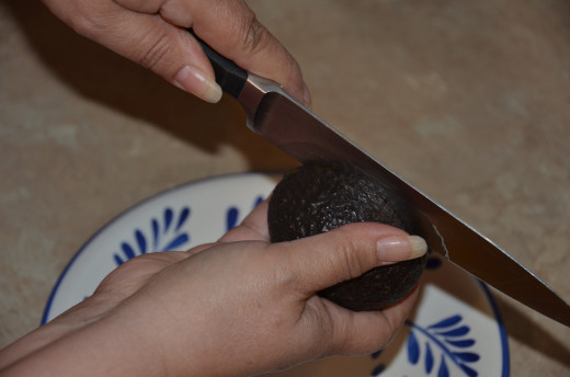 Cut all around the avocado in one lengthwise motion.