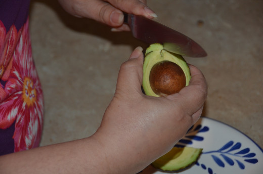 Cut lengthwise on the half of the avocado with the pit.