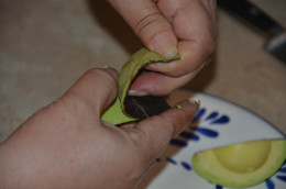Peel the skin of the avocado completely off.